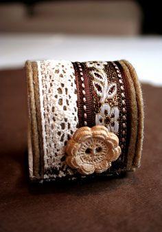Brown & creme cuff button, via Flickr.