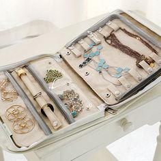 """Every design detail for this travel jewelry organizer has a functional purpose. The case doubles as a tray for putting your jewelry on in front of a mirror. It is discreet in its packaging; only you will know what valuables you have stowed. The snap-on individual pages are ideal for traveling light. Insert additional pages when you need extra jewelry storage. All pages fit into 8.5""""x11"""" drawers for storage outside the case. Made of waterproof linen, the look is chic but du..."""