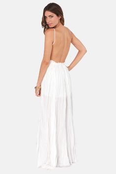 think ill order this for our rehearsal dinner! Snowy Meadow Crocheted Ivory Maxi Dress at LuLus.com!
