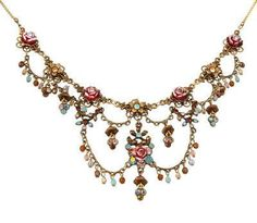 A gorgeous vintage gold flowers Michal Negrin necklace from the Michal Negrin Classic collection. This necklace comes to you on a 16 inch to 18 inch adjustable chain. Each Michal Negrin jewelry item c