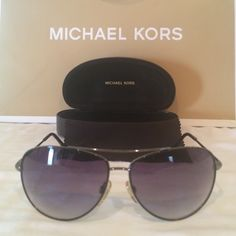 Michael Kors Classic Gunmetal Aviator MK Aviators that are previously loved.  Only normal scratches on lens. Nothing obstructive!  These are gunmetal and black.  Super classic!  Unisex MICHAEL Michael Kors Accessories Sunglasses