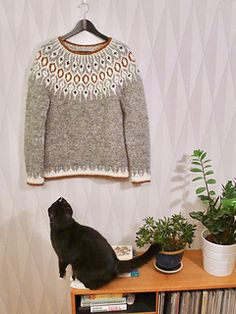 Inspired by traditional Icelandic circular yoke sweaters, Telja is knit in the round from the bottom up. Short rows are worked on the back of the sweater to bring the front of collar lower than the back. The stranded yoke is worked, and the neckline is finished with an applied i-cord.