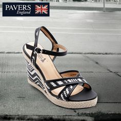 A combination of classic black with dazzling white.  These #wedges are sure to add the glam rock look to your #shoe collection.