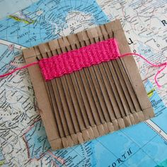 Weaving on cardboard loom - wouldn't it be cool to make a rug like this?