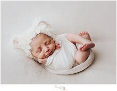 Massart Photography photographers take a baby picture during a newborn session in RI