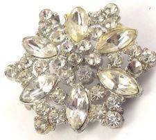 http://www.ebay.com/itm/Vintage-Silver-Tone-Clear-Rhinestone-Flower-Star-Pin-Brooch-Jewelry-Statement-/131502980270?pt=LH_DefaultDomain_0&hash=item1e9e303cae