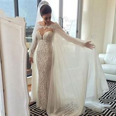 Buy wholesale wedding dress illusion plunging v neck long sleeves lace sheath wedding dress with removable cape see through back pearl buttons bridal gown which is at a discount now. missudress has guaranteed its quality. beach mermaid wedding dresses, brides wedding dress and cheap mermaid wedding dress are all in the list of superb dresses.