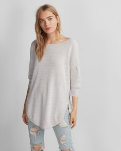 """Cozy up with this sweater that keeps your look in the now with trendy volume sleeves, plush fabric and an extreme circle hem. Designed to fit and flatter your 5'4"""" and under frame."""