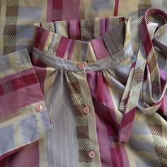 """✨VINTAGE✨ 70s button down - unique silo Boxy fit, pleated collar with ribbon, puffy shoulders, almost 3/4 sleeves with unique detail (fold over to button) - love, love, love the colors. Ship n' Shore label and former owner's label. No real flaws except two small snag on back of collar (pretty unnoticeable). No size marked so judge by measurements: 16"""" shoulder-shoulder, 21.5"""" pit-pit, 16"""" sleeves, 19.5"""" hem, 7.25"""" neck opening. Posted 2016.04.10 Vintage Tops Button Down Shirts"""