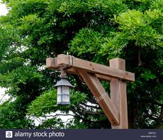 Stock Photo - Rustic wooden lamp post tied together with rope. Foliage in background. At Disney Sea, Tokyo Backyard Lighting, Outdoor Lighting, Lighting Ideas, Garden Lamp Post, Outdoor Lamp Posts, Timber Posts, Brick Pathway, Wooden Sailboat, Rustic Lamps