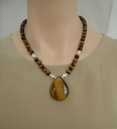 Tiger's eye and sterling silver necklace by SilverSerenade on Etsy, $42.00