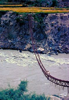 If you don't like the idea of rope or bamboo bridges then you won't like this one at all.the sides of it actually draw together as weight is applied to it. offering a truly terrifying experience,found in Northern Pakistan and made from interwoven vines
