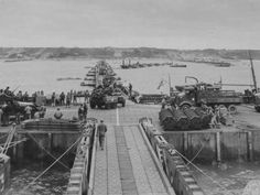 M8 Greyhound armored car and various vehicles on Mulberry causeway, June 1944.