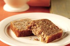 Chunky applesauce, brown sugar, cinnamon and bran flakes cereal make this easy quick loaf moist and flavorful. Serve for breakfast or a snack.