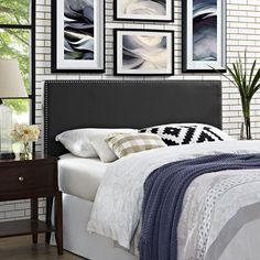 Phoebe Queen Vinyl Headboard, Black - Enhance your bedroom with the elegantly designed Phoebe Headboard in Vinyl. Minimalist and chic, Phoebe transforms with sleek lines and a stunning nail button trim accented in silver. Phoebe features a solid wood frame, adjustable black coated metal legs, fine vinyl upholstery, and dense foam padding for ultimate support. Fully Compatible with Sharon, Sherry and Helen Platform Bed Frames. Set Includes: One - Phoebe Queen Headboard. Material: Assembly…