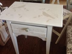Use a pre-made stencil to decorate a table top