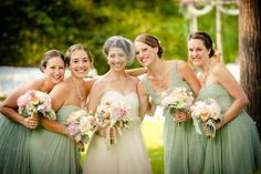 mint / sage green bridal party with cream and blush bouquets