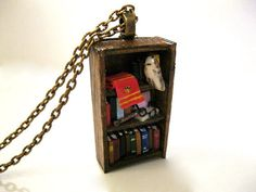 Harry Potter Bookshelf Necklace. I cant even stand how much I want this.