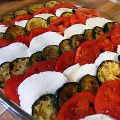 Courgette, Tomato and Mozzarella Bake Recipe Side Dishes with olive oil, zucchini, garlic, mozzarella cheese, tomatoes, grated parmesan cheese, fresh basil, salt, ground black pepper