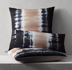 RH's Hand-Dyed Linen Shibori Pillow Cover:Our pillow cover is a modern interpretation of shibori, the ancient Japanese art of resist-dyeing fabric. Woven and dyed in the foothills of Nepal, pure linen is accordion folded, tied with string and dipped in a dye bath, creating organic, watercolor-inspired patterns that float with lightness and movement. Every step of the process is done by hand, each pillow uniquely one of a kind.