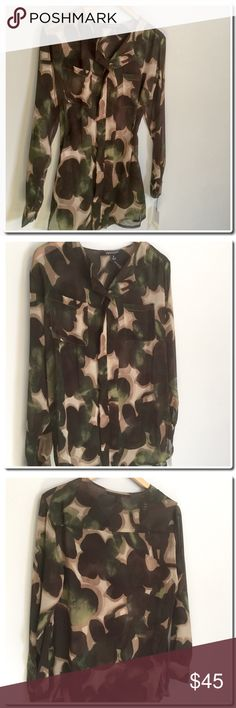 "Camo Blouse in Olive Print - Split collar - Front button closure - Long sleeves - 2 patch pockets - Allover camo print - Approx. 29"" - Imported Fiber Content 100% polyester Care Dry clean.  Chest 42"" Waist 42"" -Loose fitting Tops Blouses"