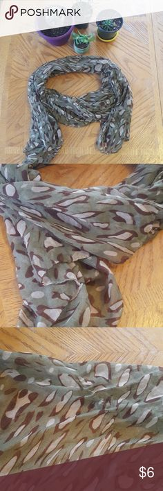 Long sheer fashion scarf Lightweight and sheer, this scarf is a dark green background a type of animal print on top. Its long. Longer than my measuring tape of 60-inches. Perfect for a bundle! Let me know if you have any questions! Accessories Scarves & Wraps