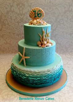 Under The Sea Sweet 16 Cake Under the Sea Sweet 16 theme. Teal ombre ruffles, shells and pencil starfish. Under The Sea Sweet 16 Cake Under the Sea Sweet 16 theme. Teal ombre ruffles, shells and pencil starfish. Sweet 15, Beach Sweet 16, Ocean Cakes, Beach Cakes, Pretty Cakes, Cute Cakes, Sirenita Cake, Sweet 16 Birthday Cake, 16th Birthday Cakes