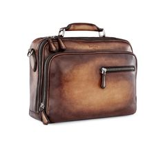 "Berluti • Paris • Bottier depuis 1895 .:  F501 - Both business and pleasure, travel time and desk time, this bag will hold your finest clothes and bulkiest files. The leather loop means you can even slip it onto the ""F1004"" rolling suitcase."