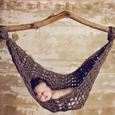 This adorable newborn hammock photography prop is handmade using a super soft thick and chunky acrylic wool blend yarn. It is the perfect baby photo prop for your sleeping newborn. And YOU get to choose the color (see the color grid for color choices and then use the dropdown menu to select your color).