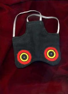 Hen saddle/apron with predator eyes to protect from hawks, etc.
