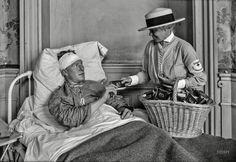 """June 24, 1918. """"Representative of American Red Cross Home Communication Service distributing cigarettes in hospital at Contrexeville, France."""" Shorpy Historic Picture Archive"""