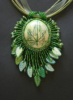 Evergreen  bead embroidered leaf pendant by Marynikydesigns, $30.00