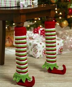 "Free Knitting Pattern for Elf Shoe Table Leg Covers - These adorable leg covers do double duty as decoration and protection for furniture during holiday gatherings. Circumference of Leg: 8"" Length: 16"". Designed by Stitch Studio Design Team"