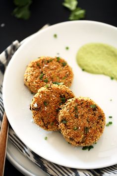 These crispy quinoa-cauliflower cakes are the perfect light lunch or appetizer. They're served with a dollop of herbed brazil nut cream.
