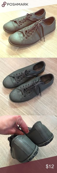 Gray leather skinny Converse Dark gray leather construction with skinny bottom. Unisex (Mens 9, Women's 11). Have been shown a lot of love- but plenty of life still in them! Converse Shoes Sneakers