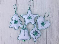 Set of 5 lovely handmade felt Christmas decorations featuring in white and green colors, ready to be hung on your Christmas tree or as a decoration anywhere in the room. It is a handmade item with great care to precision and quality, approximate size: 10 cm. Please note it is only