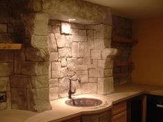 A recent bar back before finishing touches. We hand apply concrete to the wall, typically 1 to 3 inches thick, and then hand carve it to match any stone desired.