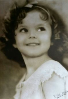 Shirley Temple - This is such a cute picture, but when does she not take a cute one? :)