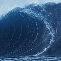90 Ft tall Huge Wave surfed by Garrett McNamara! in Nazare Portugal