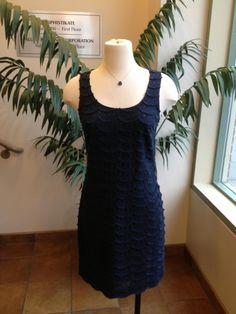 12/17: Tired of always wearing black? How about rich navy as an alternative? This Nicole Miller sheaths scalloped detail with glittery black polka dots is unique and versatile. Certainly can be dressed up for a special occasion or layered with a black turtleneck for a more casual look. Either way you got it going on!