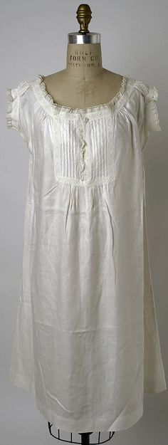Chemise c. 1860 w/ whitework trim and decorative tucked placket. From the Met Museum, accession number: C.I.41.58.26