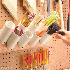 Storage Pockets for Skinny Things - Saw off short pieces of 1-1/2-, 2- or 3-in. PVC plumbing pipe with 45-degree angles on one end. Screw them to a board to hold paint brushes, pencils, stir sticks and just about any other narrow paraphernalia in your shop. Mount them by drilling a 1/4-in. hole in the angled end, and then drive a 1-5/8-in. drywall screw through the hole into the board.PVC plumbing pipe