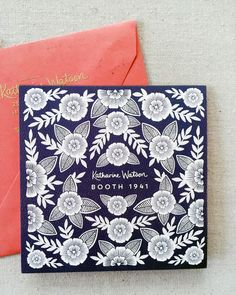 Navy and white floral invitation design. Coral envelope with debossed gold metallic lettering