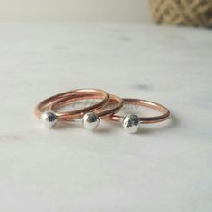 Copper set with sterling silver ball.