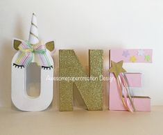 Unicorn letters, one letters,paper mache,8inches tall,unicorn party decorations,unicorn photo props,first birthday party decorations, by Awesomepapercreation on Etsy https://www.etsy.com/listing/533515166/unicorn-letters-one-letterspaper