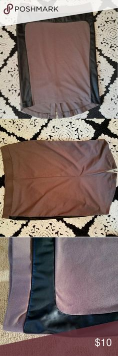 Mossimo Brown & Black Faux Leather Slit Skirt Like new, only worn once! This cute and flirty skirt features a 8 inch slit up the back. 76% polyester, 20% rayon, 4% spandex. The waist is 19 inches across unstretched and 25 inches long. Mossimo Skirts Pencil