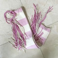 Burberry Fringe Scarf Super cute and fun Burberry scarf with fringe detailing. Beautiful colors; 90% Merino Wool, 10% Cashmere. Authentic and in perfect condition. Very soft and cozy. Willing to bundle with Blue and Red scarf as well. Burberry Accessories Scarves & Wraps