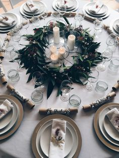 Australian Christmas table arrangement. Native wreath garland made using eucalyptus leaves, Christmas Bush and Jasmine. Hand made Christmas crackers used in lieu of place cards.