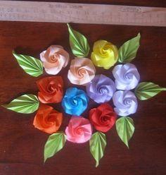 Цветы — розочки из бумаги в стиле оригами. новыесм фотовопросы задавайтедар для одного человекапересылка за счет одариваемого...