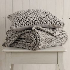 A real talking point, these stunning oversized knits will add instant texture, style and cosiness to any Spring bed. Plain knit reverse on cushion cover.